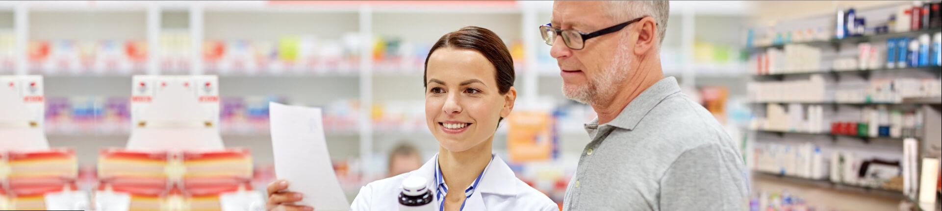 Pharmacist and elderly man buying drug at pharmacy